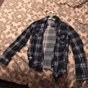 Plaid button down long-sleeved shirt.